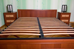 Bed with wooden slats for bed frame. Bedroom interior Stock Image
