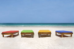 Bedchairs in different colors facing the sea Royalty Free Stock Image