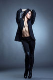 Beddable woman posing topless in stylish clothes Stock Images