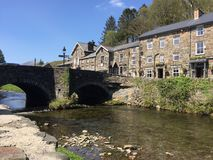 Beddgelert village in Snowdonia and bridge. River Colwyn, flowing gently in front of some old stone cottages in Beddgelert, Snowdonia, on a beautiful sunny day royalty free stock photos
