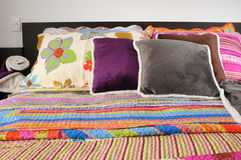 Bedding. Colorful bed spreads and cushions Stock Images