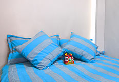 Bedding. Furniture and blue color bedding, and colorful  on bed, shown as comfortable life Royalty Free Stock Photos
