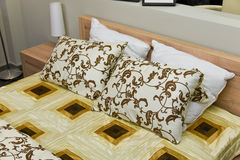 Bedding detail. Bedroom detail - view of nice bedding with pillows Stock Images