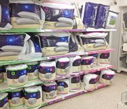 Bedding, duvets and pillows in a store. Stock Image