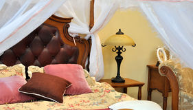 Bedding and furniture interior. Warm color bedding and furniture interior, with white curtain, shown as home environment and comfortable life Stock Images