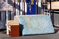 Bedding and furniture in the street at Benidorm. Waste bedding and furniture in the street at Benidorm, Spain ready for disposal Royalty Free Stock Photos