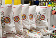 Bedding and home textile store. Pillows and blankets in home textile section in a department store stock images
