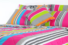 Bedding. Isolated. Stripped bed spreads with soft pillows Royalty Free Stock Photography