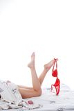 Bedding, legs, bra Stock Images