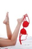 Bedding, legs, bra Stock Image