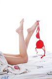 Bedding, legs, bra Royalty Free Stock Photo