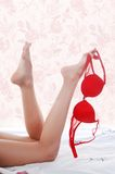 Bedding, legs, bra Stock Photo