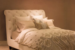 Bedding. Neutral tone plush bed and pillows Royalty Free Stock Photo