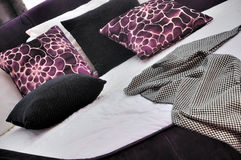 Bedding with purple pillow. Deep color bedding and pillow, with white sheet, shown as home featured furniture and simple style Royalty Free Stock Photos