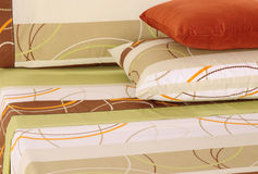 Bedding set. Freshly arranged complete bed set Stock Image