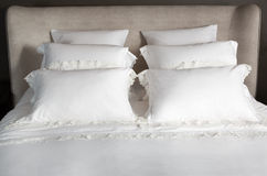 Bedding and six pillows Royalty Free Stock Image