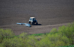 Bedding spring crops_4. Track rollers with tractor prepares soil for planting spring crops Stock Image