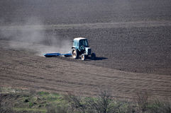Bedding spring crops_7. Track rollers with tractor prepares soil for planting spring crops Stock Photo