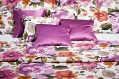Beddings with pink floral design Stock Image