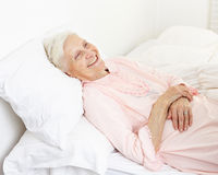 Beddridden senior citizen woman Royalty Free Stock Images