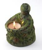 Bedecken Sie Kerze mit Erde Stockfotos