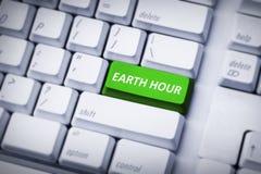 Bedecken Sie Stunde auf grünem und weißem Tastaturknopf mit Erde Lizenzfreie Stockbilder