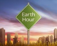 Bedecken Sie Stundengruß auf Verkehrszeichen bei Sonnenuntergang mit Erde Stockbild