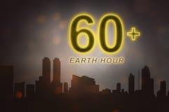 Bedecken Sie Stundenmitteilung mit erde, um Elektrogeräte in Minute 60 abzustellen Stockfoto