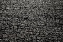 Bedekte stad met porfierkubussen Textuur van Kei Vloer van een straat met steentegels royalty-vrije stock afbeeldingen