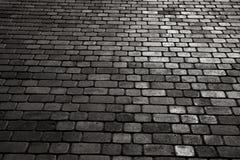 Bedekte stad met porfierkubussen Textuur van Kei Vloer van een straat met steentegels stock foto's