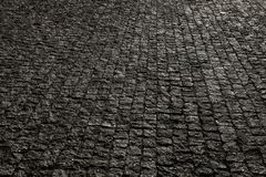 Bedekte stad met porfierkubussen Textuur van Kei Vloer van een straat met steentegels royalty-vrije stock fotografie