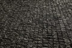 Bedekte stad met porfierkubussen Textuur van Kei Vloer van een straat met steentegels stock foto