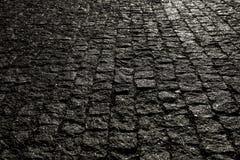 Bedekte stad met porfierkubussen Textuur van Kei Vloer van een straat met steentegels royalty-vrije stock afbeelding