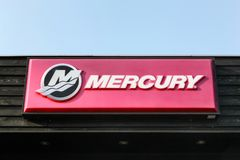 Mercury logo on a building. Beder, Denmark - April 20, 2018 : Mercury logo on a building. Mercury Marine, founded in 1939 is a division of the Brunswick Stock Image