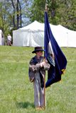 "Boy Carrying a Flag at the ""Battle of Liberty"" - Bedford, Virginia. Bedford County, Virginia, USA – April 29th: A Young Reenactor with flag at royalty free stock photos"