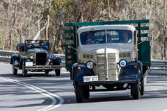 1946 Bedford KM Truck driving on country road. Adelaide, Australia - September 25, 2016: Vintage 1946 Bedford KM Truck driving on country roads near the town of Royalty Free Stock Image