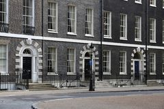 Bedford Square, London. Bedford Square in Bloomsbury, West End of London, UK - Georgian front doors stock image