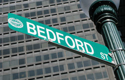 Bedford Street sign Boston. Closeup of Bedford Street sign with modern high rise building in background, Boston, Massachusetts, U.S.A Royalty Free Stock Images