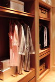 Bedgown in a wood garderobe Royalty Free Stock Image