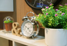 Bedhead decoration with plants and clock royalty free stock images