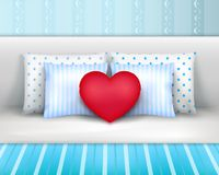 Bedlinnen Pillows Cushions Realistic Composition. Pillows set on bed by headboard realistic composition with striped bedlinnen and heart shaped cushion vector Stock Image