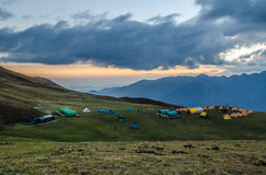 Bedni Bugyal Campsite - Roopkund Trek. A view Bedni bugyal campsite during sunset, Uttarakhand, India royalty free stock photo
