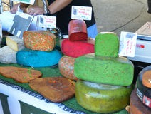 BEDOIN, FRANCE - AUGUST 1, 2016: French cheese of differents color at the market in Provence. France Royalty Free Stock Photos