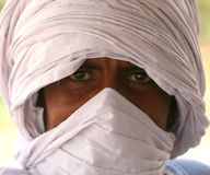 Bedouin. Man with a turban in the dry period in West Africa royalty free stock images