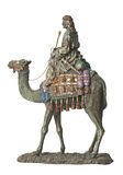 Bedouin on camel. Bronze antiques statuette of bedouin on camel royalty free stock photography