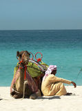 Bedouin with camel on the beach in Dubai Stock Photo