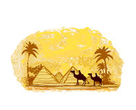 Bedouin camel caravan in wild africa landscape Royalty Free Stock Photos