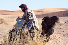 Bedouin with camel, Morocco Royalty Free Stock Images