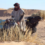 Bedouin with camel, Morocco Royalty Free Stock Image