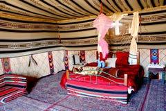 Bedouin camp. Wadi Rum, Jordan - December 11,2012: Bedouin style tents in Wadi Rum, Jordan. Interior of double bedroom with sofa and carpet. Bedouin style tents stock image